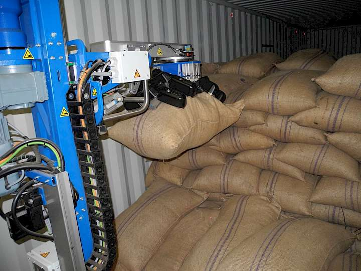 The jute bags are taken out of a container by a unique fully automatic mechanism and placed on an extendible conveyor belt.